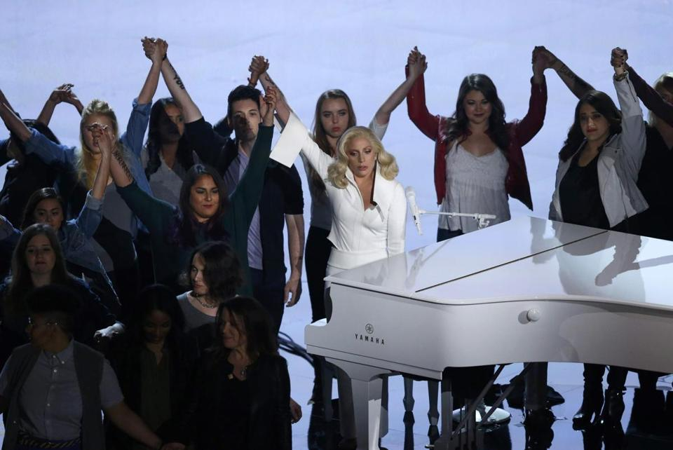 "Lady Gaga sang her Oscar-nominated song ""Til It Happens to You"" while surrounded by survivors of sexual abuse."