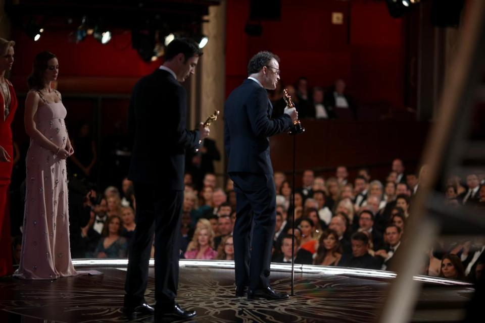 Screenwriter Josh Singer (left) and screenwriter-director Tom McCarthy accepted the award for Best Original Screenplay award at the 88th Annual Academy Awards Sunday night.