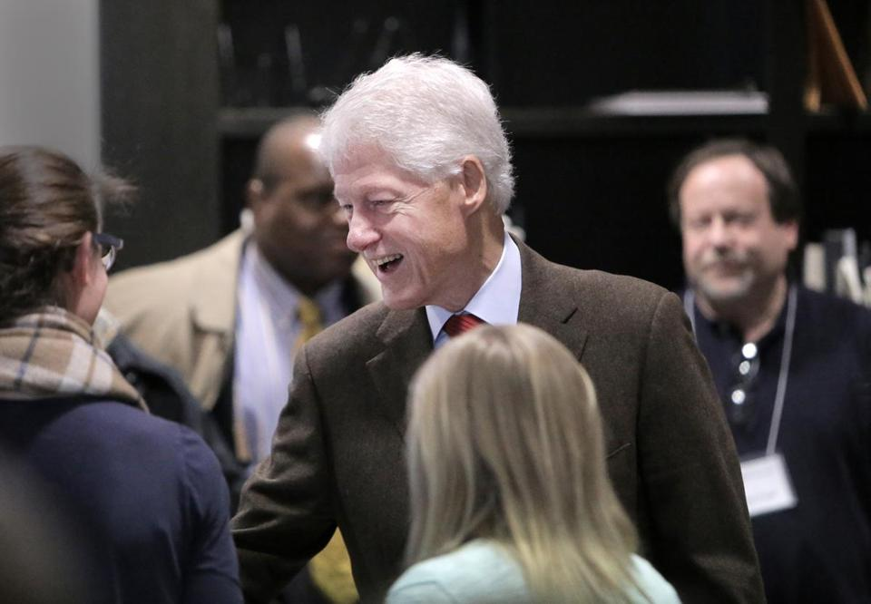 Former President Bill Clinton greeted people inside the Newton Free Library, a polling place, during Tuesday's primary election.
