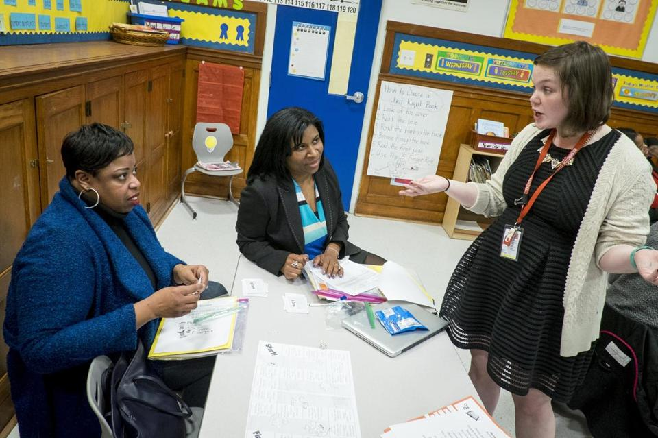 First-grade teacher Emily McNally talked with Keisha Smith (left) and Miesha Holmes in the Beers school's new style of parent-teacher conference.