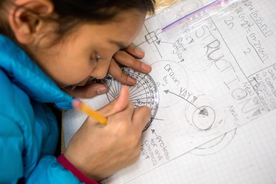 Nina Shah, 11, used a protractor at the Russian School of Mathematics in Newton.