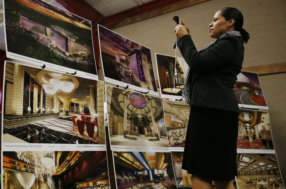 A member of the audience took cell phone photos of the new designs for First Light Resort and Casino in Taunton.