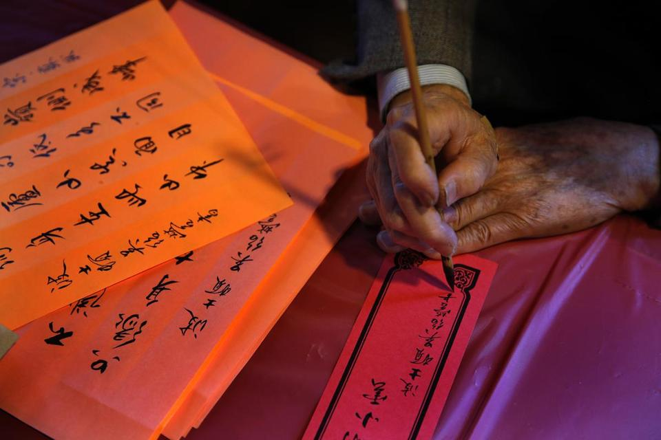 Wu Shao Ying, 90 years old, still has a steady hand for Chinese calligraphy. He used to be a school principal in China.