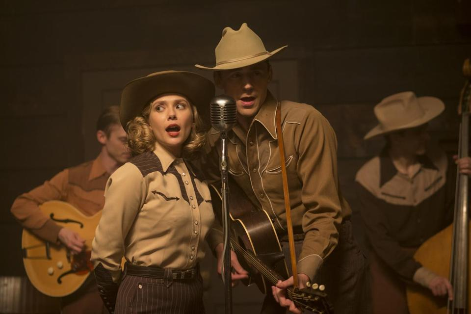 "Elizabeth Olsen as Audrey Williams and Tom Hiddleston as Hank Williams in ""I Saw the Light."""
