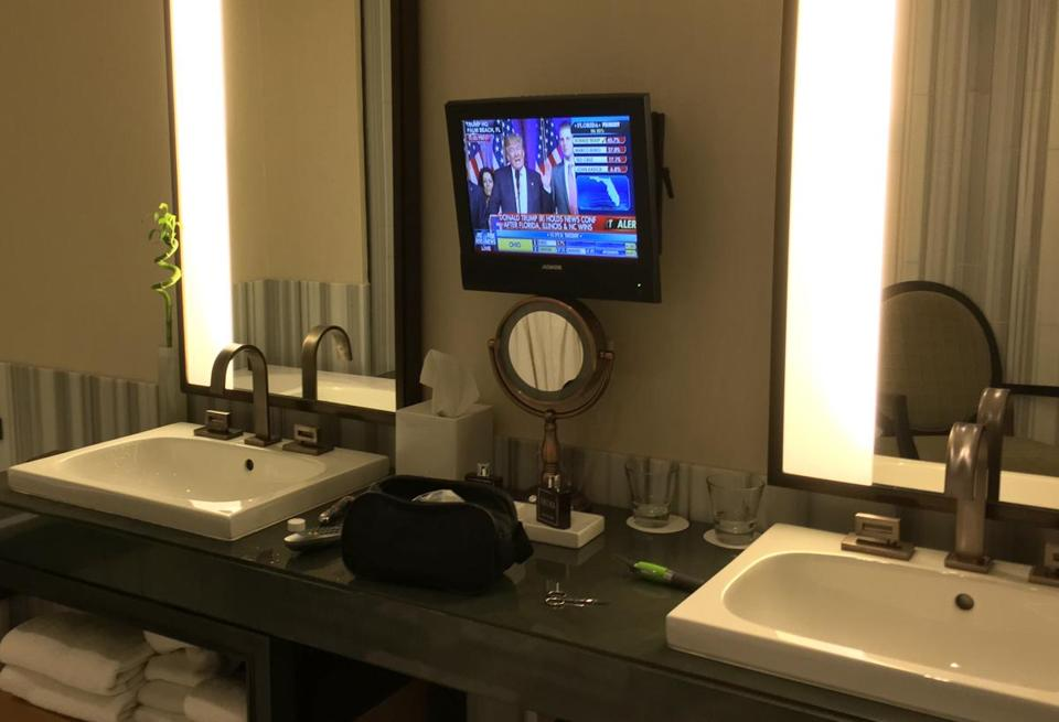 Donald Trump gave a victory speech on Tuesday night, viewable on the flat-screen TV in the bathroom of one of the 391 rooms in the Trump SoHo New York.