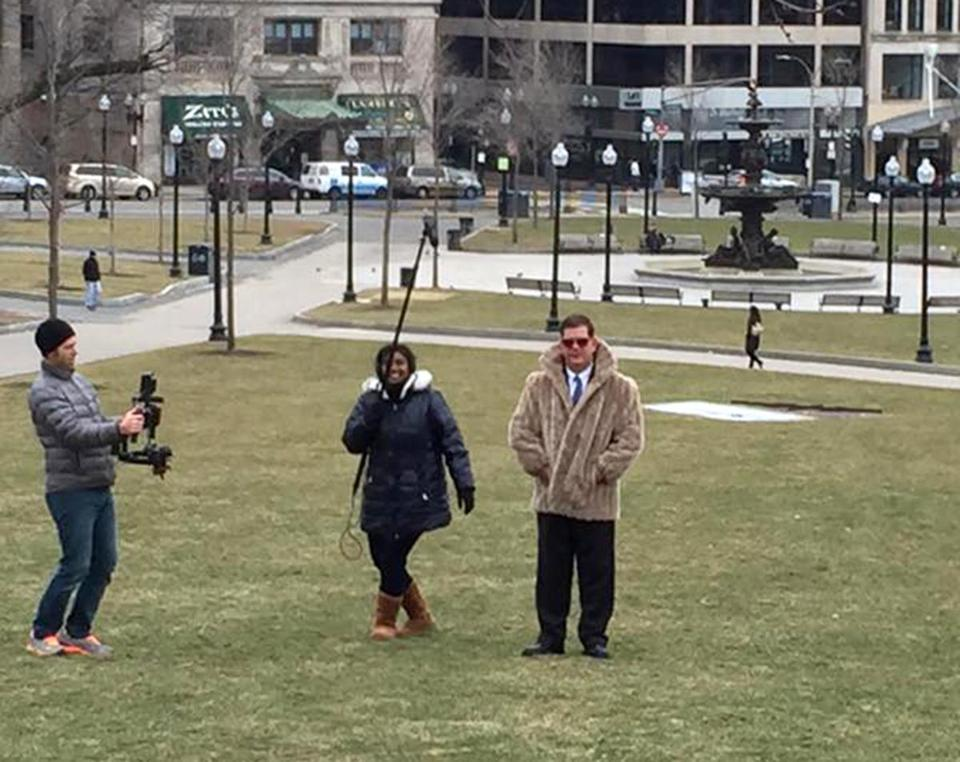 DO NOT USE MORE THAN 2 columns-- Boston Mayor Martin Walsh wearing a fur coat during the Adele video shoot. (City of Boston)