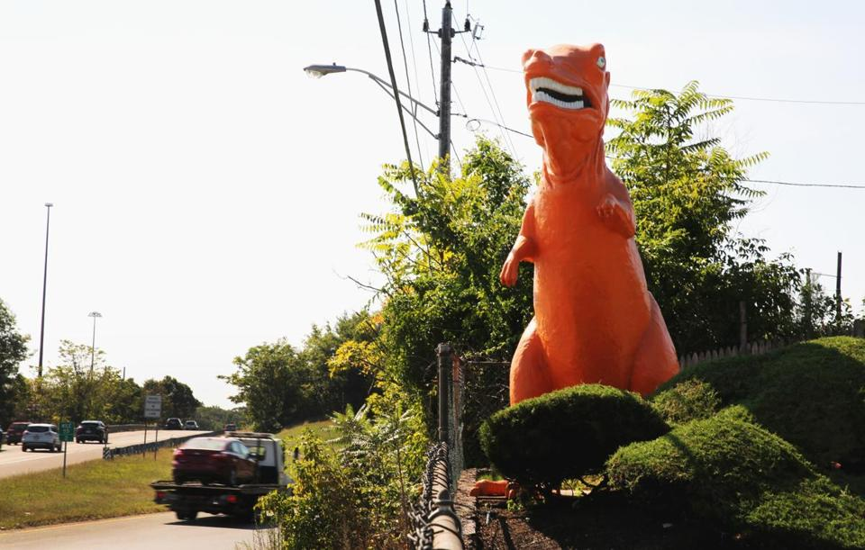 The dinosaur has overlooked the mini-golf course for decades.