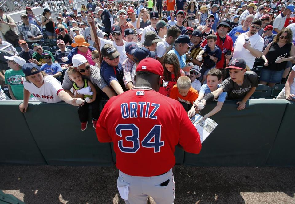 Red Sox DH David Ortiz signed autographs for fans before a spring training game last month. The Red Sox are scheduled to open their season Monday at Cleveland.