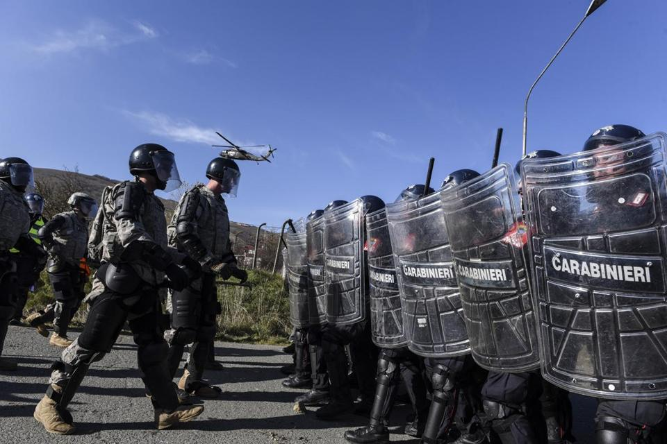 Riot policemen and US soldiers serving in a NATO-led peacekeeping force practice riot control exercises near the village of Vrelo, Kosovo, in November.