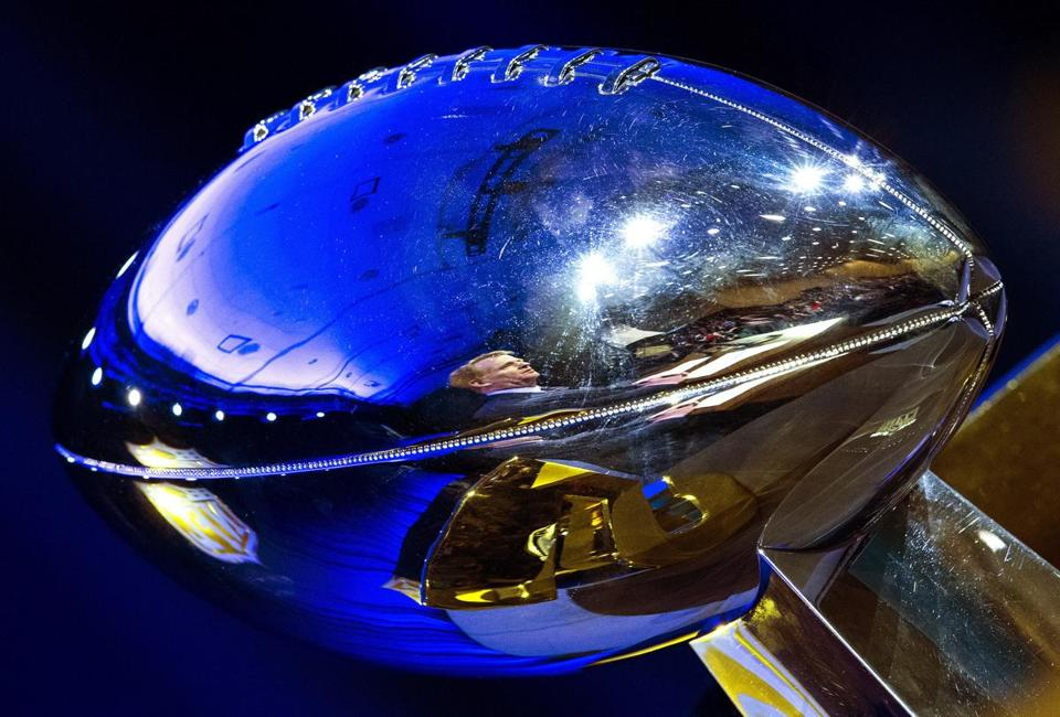 NFL Commissioner Roger Goodell, reflected in the Lombardi Trophy at a news conference two days before the Super Bowl, in San Francisco, Feb. 5, 2016. Peppered with questions about the risks of degenerative brain disease, Goodell mostly echoed previous statements about what the league is doing to improve player safety and said he would encourage his son to take up the sport, if he had one. (Doug Mills/The New York Times)