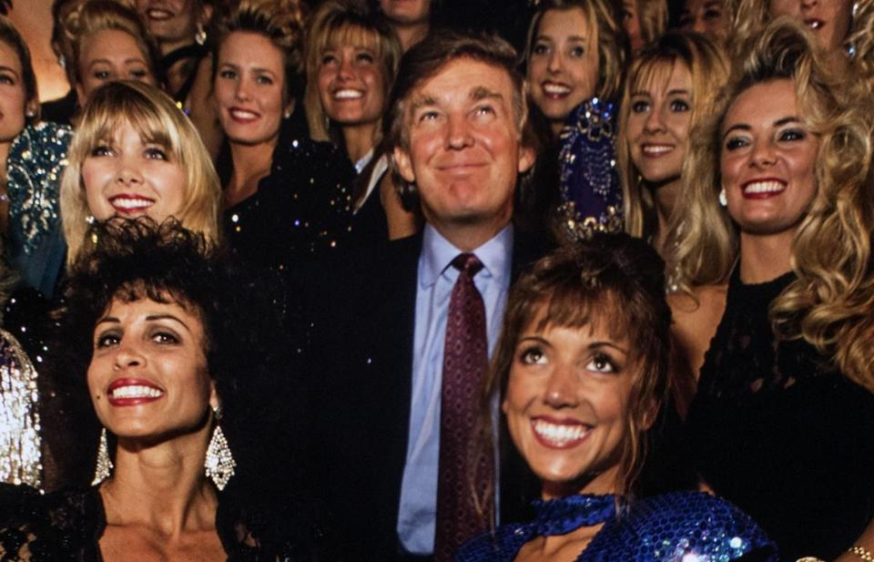 Donald Trump posed with calendar models at the Plaza Hotel in 1993.