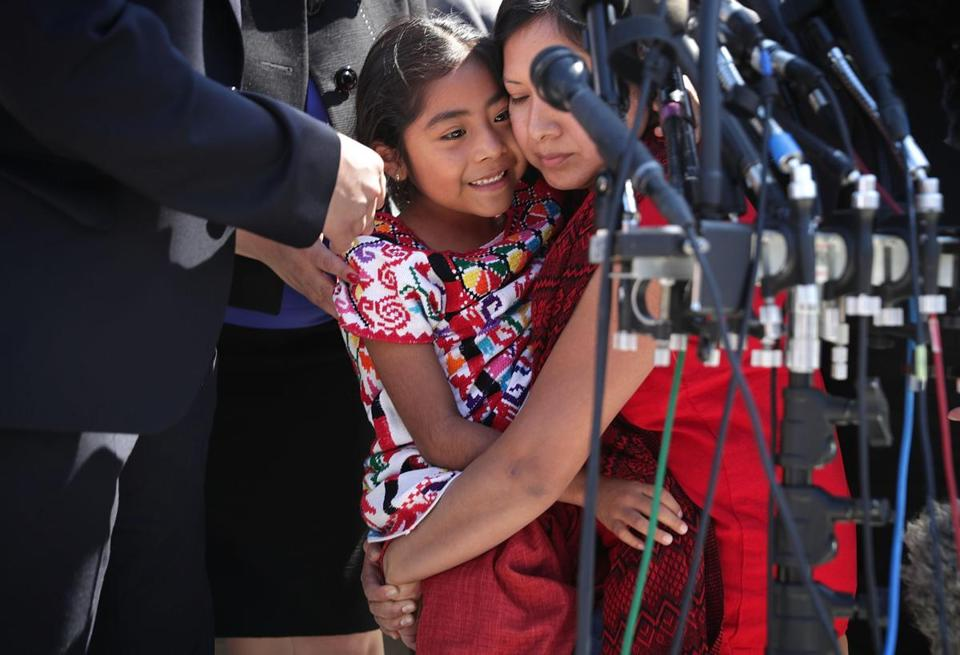 Six-year-old Sophie Cruz  of Los Angeles was held by her mother Zoyla Cruz in April 2016 outside the US Supreme Court.