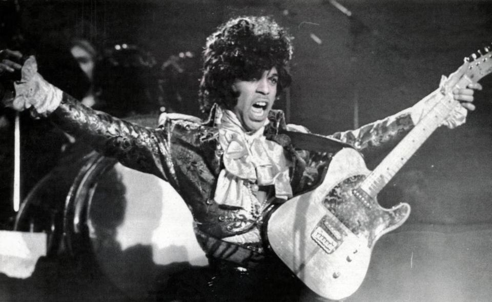 Worcester, MA - 3/27/1985: Prince shows his appreciation to the crowd during the first of two sold out shows at the Worcester Centrum in Worcester, Mass., on March 27, 1985. (Chris Christo/UPI) --- BGPA Reference: 160421_MJ_009 22princeappreciation Prince Rogers Nelson