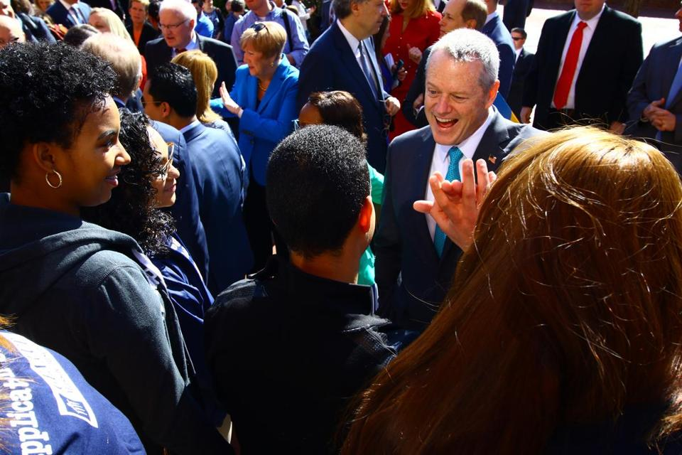 Governor Charlie Baker high fived Lawrence High School students after the announcement of the new college affordability plan.