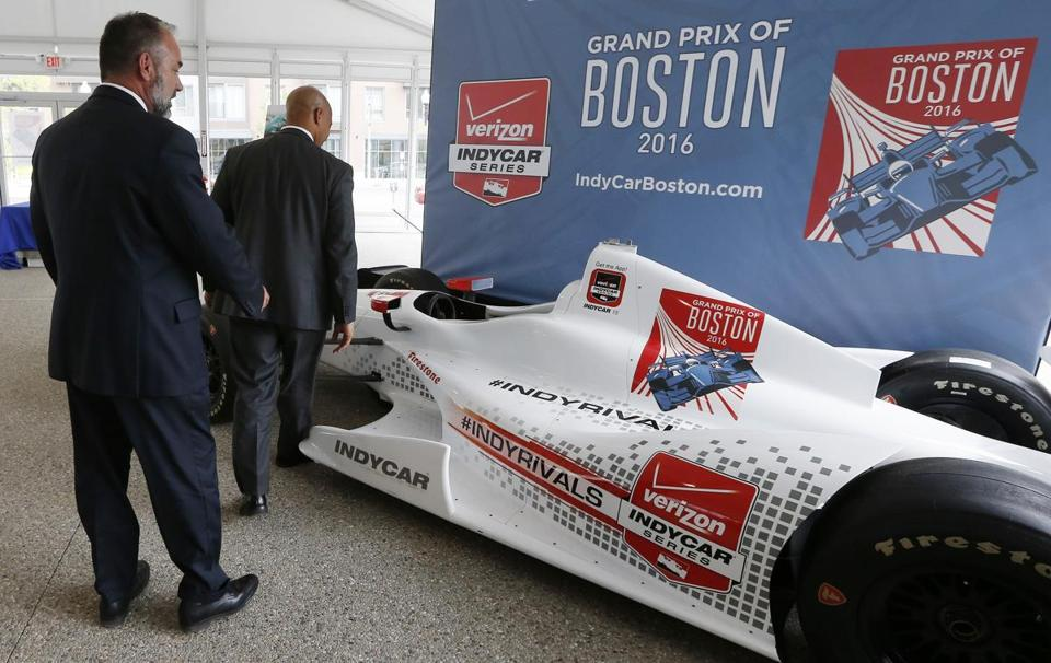 City of Boston Chief of Economic Development John Barros, right, and Tourism, Sports and Entertainment director Ken Brissette, left, examine an IndyCar mock-up following a news conference in Boston, Thursday, May 21 2015, announcing the inaugural Grand Prix of Boston scheduled for Labor Day weekend 2016. (AP Photo/Michael Dwyer)