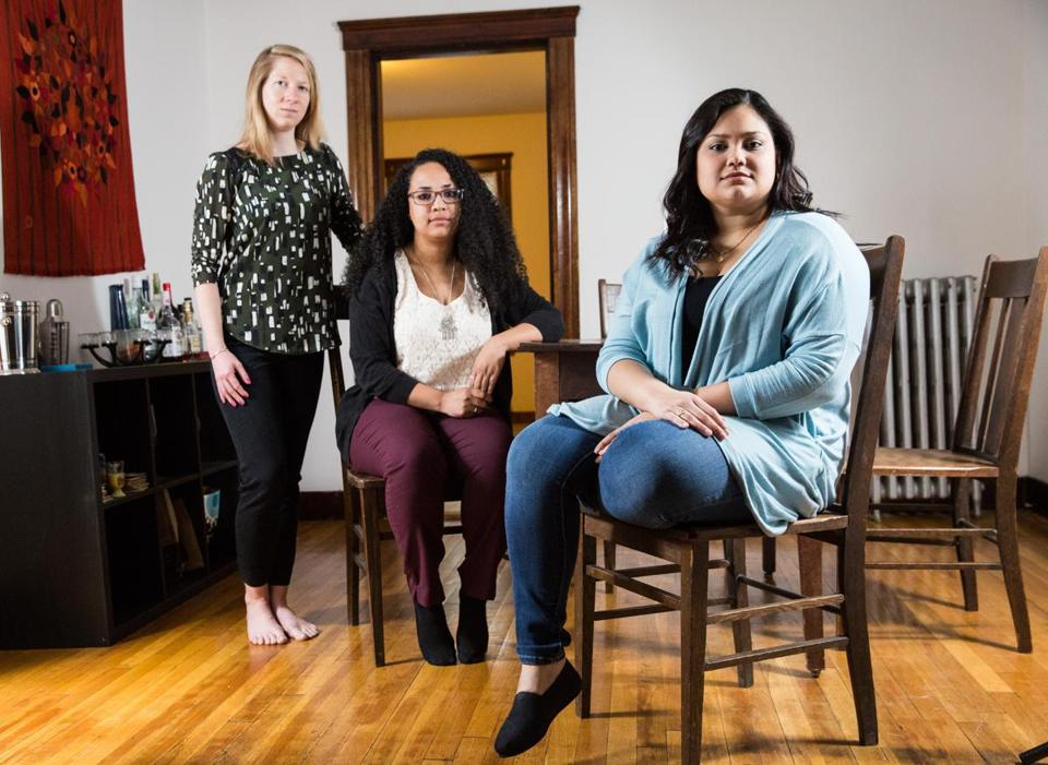 Jamaica Plain roommates (from left) Ashley Charron, Renata Caines, and Luisa Centeno Silva are all struggling to pay off college loans.