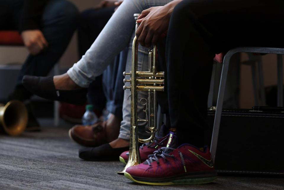 A Boston Arts Academy student sat with a trumpet between his feet at an event at Berklee College of Music.