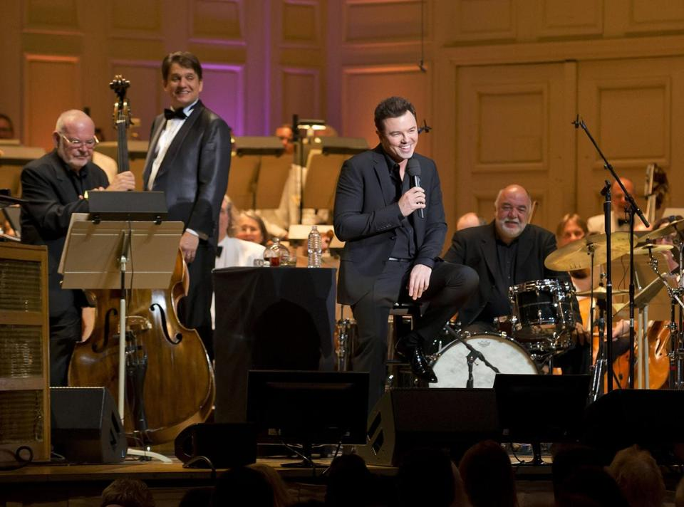 Seth McFarlane (front, center) with conductor Keith Lockhart  (second from left) and the Boston Pops on Friday.