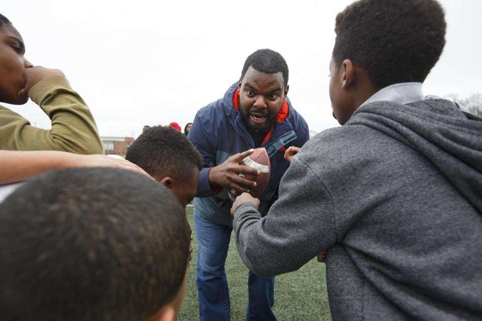 5/4/16 - Randolph, MA - Derrick Bell, cq, led school-aged kids in a game of touch football as part of an afterschool program that he leads. Bell took on a lot of student debt at before finding his way at Bunker Hill community college. He runs an extended day program in Randolph and advises his older students of limited means who are thinking about college to strongly consider community college. Item: 052216StudentDebt(5). Photo by Dina Rudick/Globe Staff.