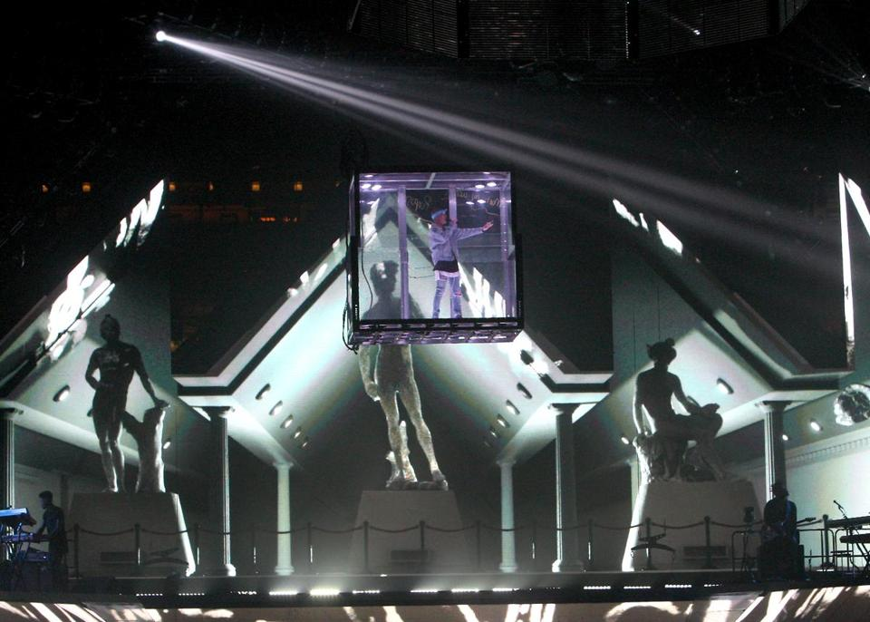 During one song, Bieber was encased in a Plexiglass box.