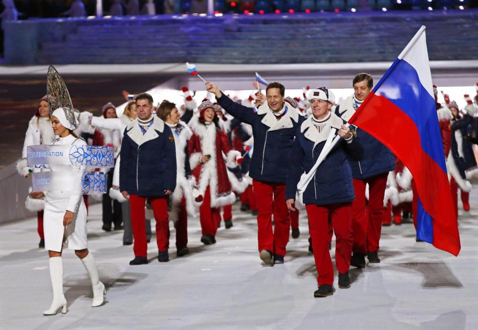 epa05303427 (FILE) A file picture dated 07 February 2014 of Team Russia with flag bearer Alexander Zubkov (R) during the Opening Ceremony of the Sochi 2014 Olympic Games at the Fisht Olympic Stadium in Sochi, Russia. The International Olympic Committee (IOC) on 13 May 2016 called for immediate investigations on allegations of Russian state-sponsored doping at the Sochi 2014 Olympic Games. Grigory Rodchenkov, former head of Russia's anti-doping laboratory, admitted that banned performance-enhancing substances have been supplied and urine samples have been exchanged before and during the Sochi 2014 Olympics, the New York Times reported on 12 May 2016. EPA/BARBARA WALTON *** Local Caption *** 51215598