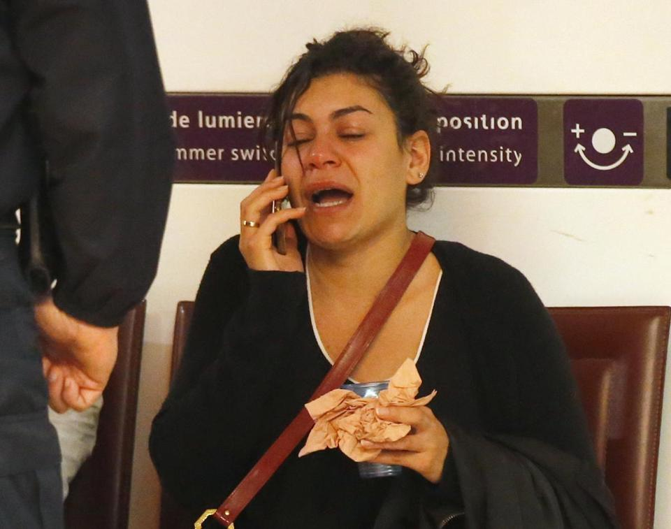 A relative of one of the victims aboard EgyptAir Flight 804 reacted while making a phone call at Charles de Gaulle Airport outside of Paris Thursday.