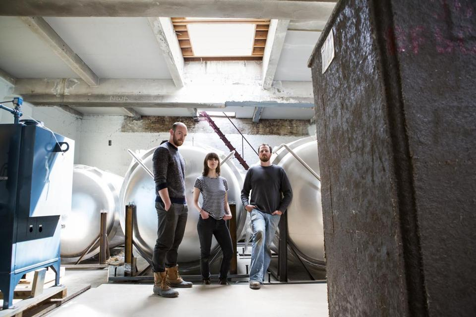 The Lamplighter team: cofounders AC Jones and Cayla Marvil with head brewer Tyler Fitzpatrick.
