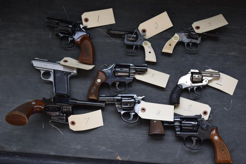 Police collected 16 guns in a gun buyback program this past May, including those shown here.