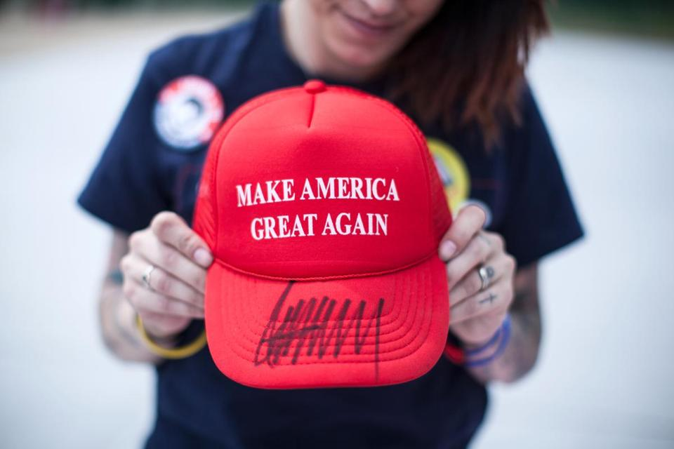 "Diana Noschang, of Newburgh, N.Y., holds a ""Make America Great Again"" hat autographed by Republican presidential candidate Donald Trump, Monday, April 25, 2016, in Wilkes-Barre, Pa. (Christopher Dolan/The Times & Tribune via AP) WILKES BARRE TIMES-LEADER OUT; MANDATORY CREDIT"