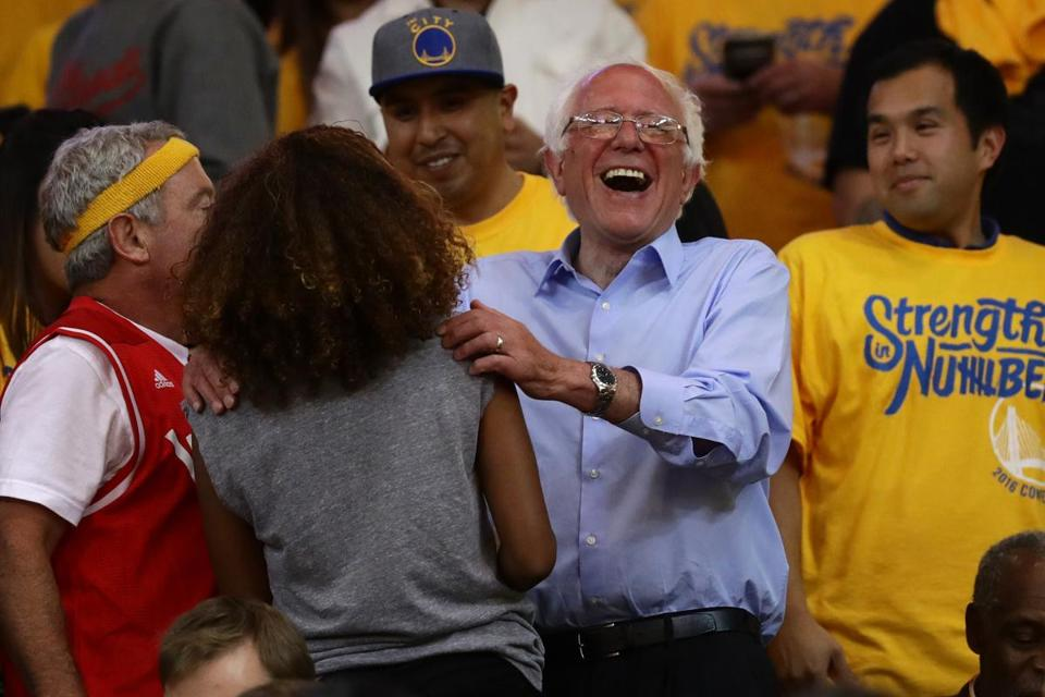 Democratic presidential candidate Bernie Sanders shared a laugh with fans during the second half of Game 7 of the NBA's Western Conference finals.