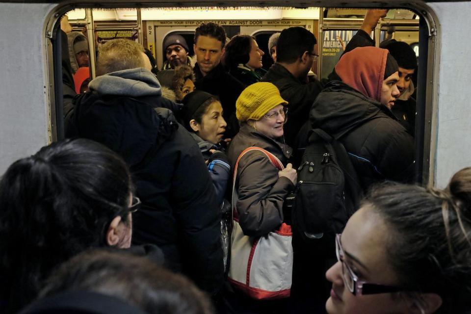 BOSTON Ñ 2/19/2015: People cram into an Orange Line train on Thursday. Commuters faced long lines and crowded trains again, often leaving people to wait ten or more minutes for the next train to arrive. (Sean Proctor/Globe Staff)