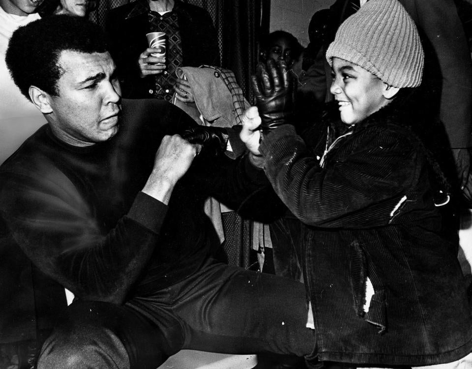 Muhammad Ali sparred with a young fan at a benefit event at Boston's Hynes Auditorium in 1977.