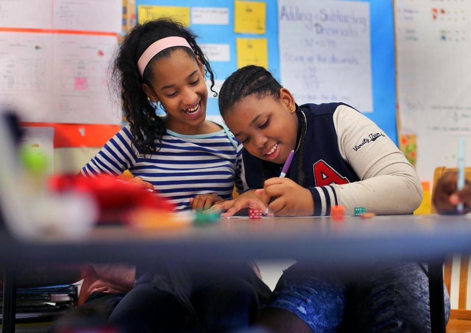 Dorchester- 6/10/2016 Math tutors work in small groups at the Dever Elementary School. Sonia Luzon(cq) age 12(left) and Shawniya Smith(cq) age 11 work together on a math problem in a 5th grade math class. Boston Globe staff photo by John Tlumacki(metro)