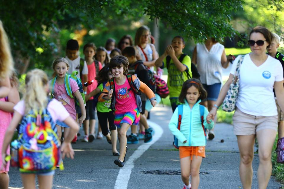 In Salem, the Carlton Innovation School holds a weekly trek to school called Walking Wednesday. - MARK LORENZ FOR THE BOSTON GLOBE