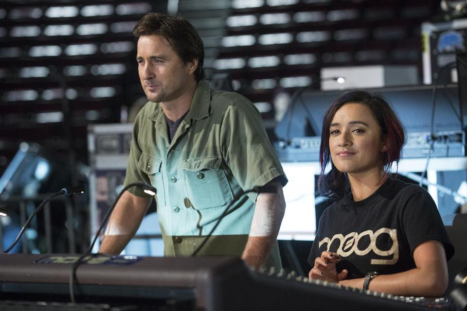 "Luke Wilson and Keisha Castle-Hughes in Showtime's ""Roadies."""