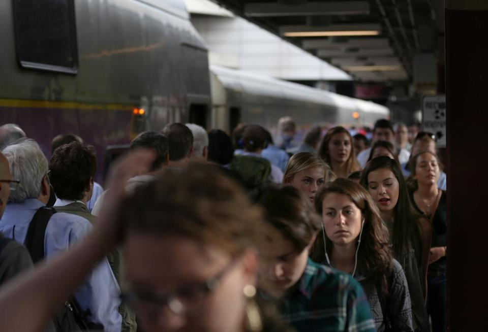 Commuters walked along a crowded South Station platform. The proposed South Coast rail line to New Bedford and Fall River would terminate there.
