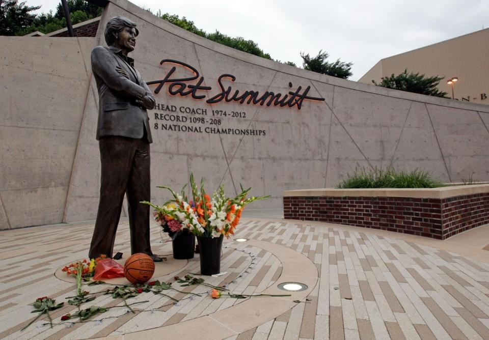 Fans left flowers and a basketball Tuesday at a statue honoring Summitt in Knoxville.