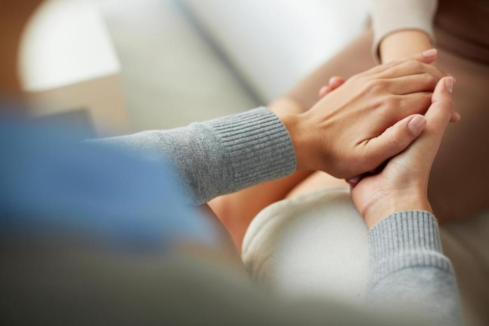Close-up of psychiatrist hands together holding palm of her patient; Shutterstock ID 229879537; PO: OPED