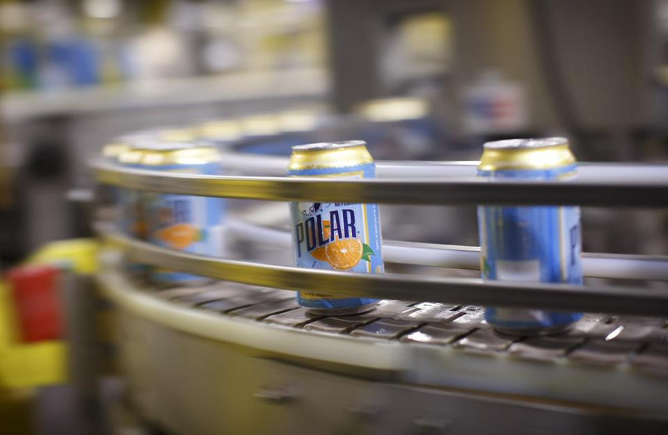 Thousands of of cans are directed along a conveyor belt at the Polar Seltzer production facility in Worcester.