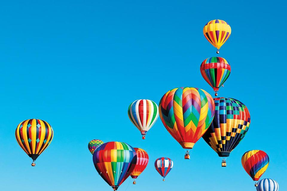 colorful hot air balloons against blue sky; Shutterstock ID 156212849; PO: 0717 week ahead