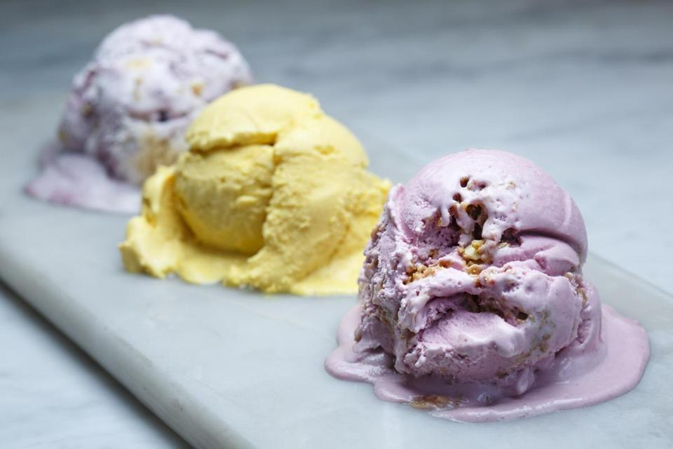 7/14/16 - Boston, MA - FoMu South End - (From right to left) This is FoMu's Almond raspberry crumble ice cream, mango habanero ice cream, and blueberry shortbread ice cream, left, in FoMu's new South End location. Story by Catherine Smart/Globe Staff. Topic: 27icecream. Photo by Dina Rudick/Globe Staff.