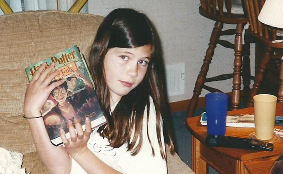"The author with her prized copy of ""Harry Potter and the Goblet of Fire."""