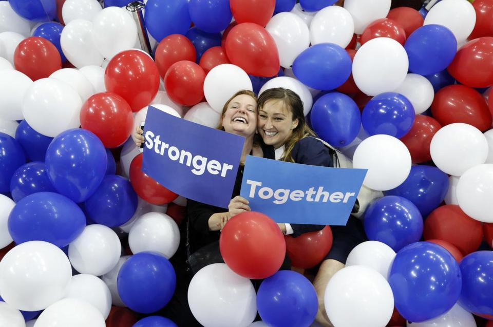 Campaign staffers for Hillary Clinton pose in balloons on the floor after the Democratic National Convention Thursday.