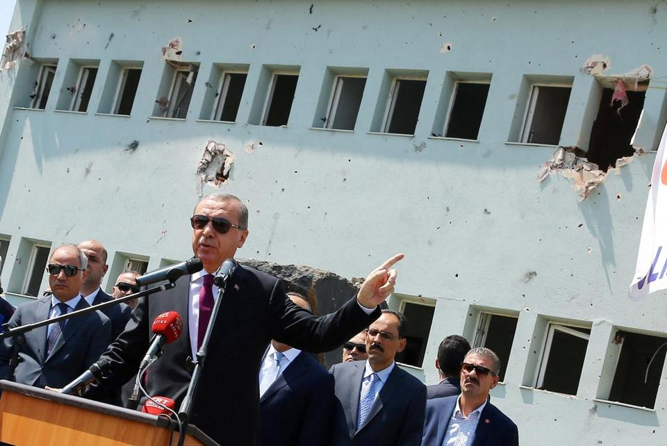 Turkey's President Tayyip Erdogan addresses the audience as he visits the Turkish police special forces base damaged by fighting during a coup attempt in Ankara, Turkey, July 29, 2016. Kayhan Ozer/Courtesy of Presidential Palace/Handout via REUTERS ATTENTION EDITORS - THIS PICTURE WAS PROVIDED BY A THIRD PARTY. FOR EDITORIAL USE ONLY. NO RESALES. NO ARCHIVE.