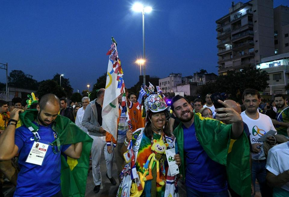 Supporters took a selfie as they gather outside the Maracana stadium in Rio de Janeiro on Friday, ahead of the opening ceremony of the Rio 2016 Olympic Games