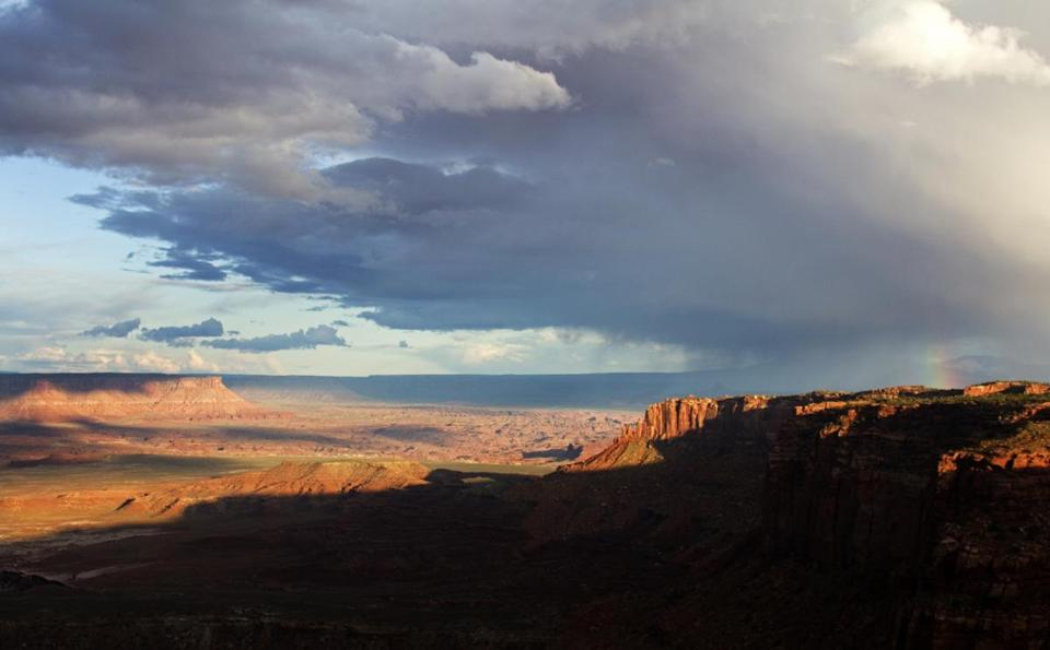 An afternoon spent along the trail to Grand View Point at Island in the Sky featured a curtain of rain passing over the canyons, with a rainbow coda.