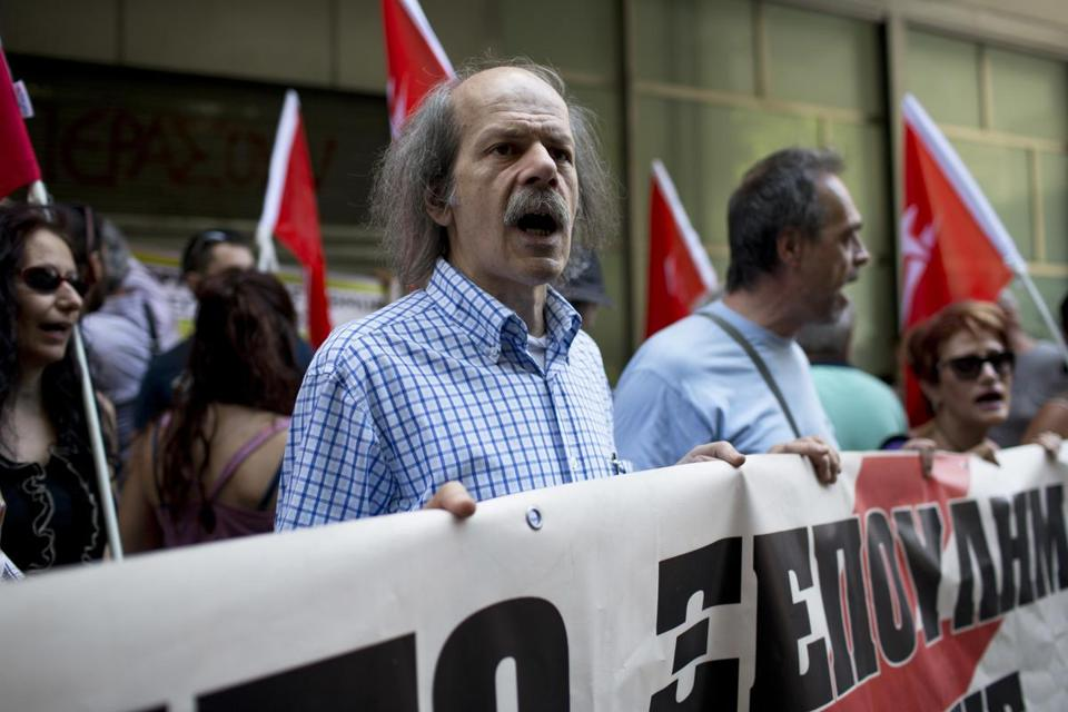 Workers from the state-controlled Public Power Corporation protest outside the Finance Ministry in central Athens during a three-hour work stoppage on Monday, July 11, 2016. A union representing PPC workers accused Greece's left-wing government of giving in to pressure from international bailout lenders and planning to expand privatization of the company. (AP Photo/Petros Giannakouris)