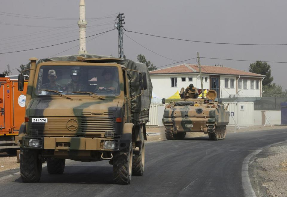 Turkish armored vehicles headed toward the Syrian town of Jarablus on Thursday.