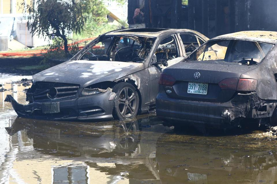 Two of three cars that were destroyed in a by the fire.