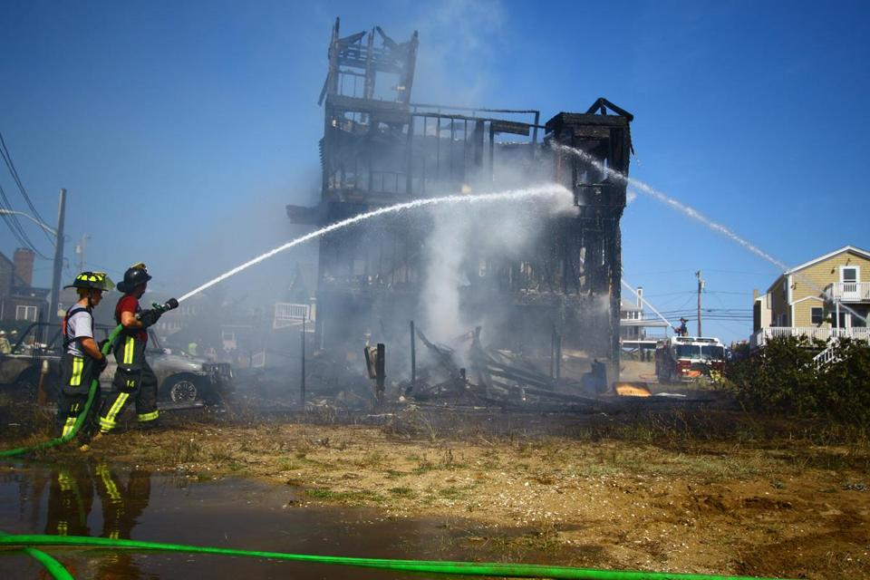 Crews doused the site of the fire on Saturday.